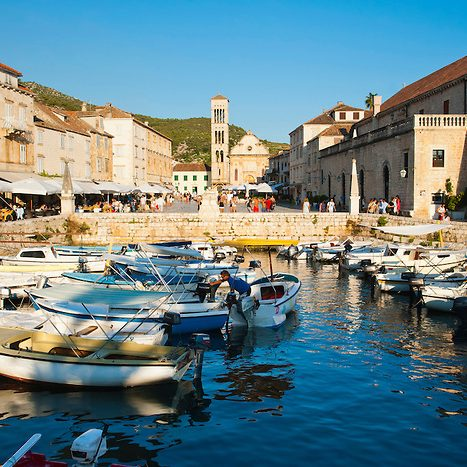 Photo of Hvar harbor, St Stephens Square and St Stephens Cathedral in Hvar town centre, Hvar Island, Dalmatia, Croatia, Europe. This is a photo of Hvar harbor and St Stephens Cathedral in St Stephens Square, Hvar town centre. Hvar town is the main town on Hvar Island which is one of the most popular islands in Dalmatia thanks to beautiful St Stephens Square and harbor area.